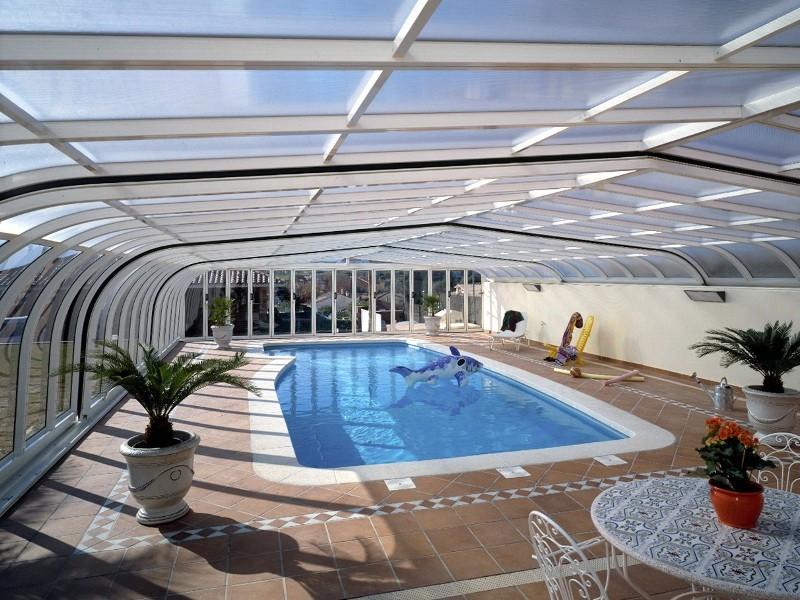 Piscines coques forme libre for Forme piscine coque